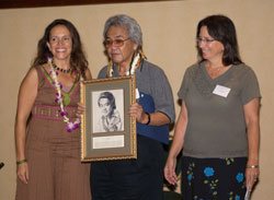 Donelle Camarillo (portrait artist), and Nuni  Walsh (UHoFM) presenting Herb Ohta with his Ukulele Hall of Fame induction portrait, November 2006