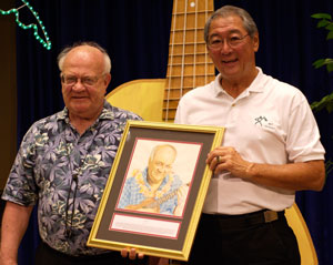 Byron Yasui presenting Lyle with his Ukulele Hall of Fame portrait at his induction ceremony at the Portland Ukulele Festival, June 2007