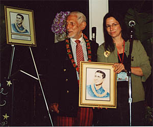 Nuni Walsh of the Ukulele Hall of Fame presents Bill Tapia with his Hall of Fame induction portrait at Ukulele Expo's Uke Fest West, April 2004